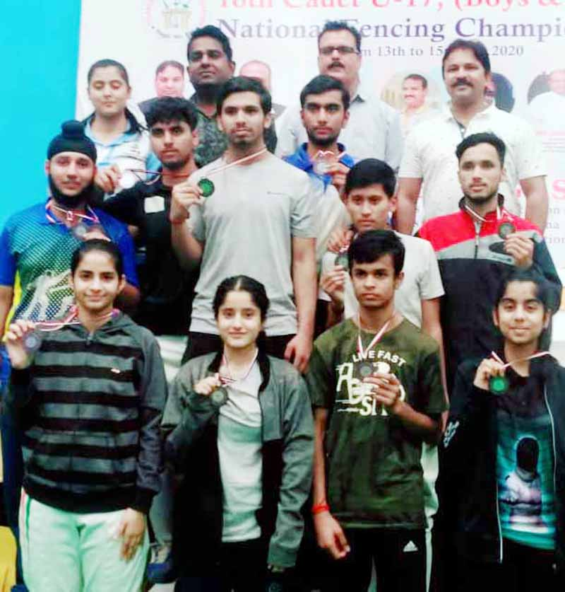 Medal winners in the Cadet and Under-17 National Fencing Championship pose with coach, Shotu Lal Sharma.