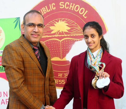 Gymnast Bavleen Kour being honoured by Principal KCPS on Friday.