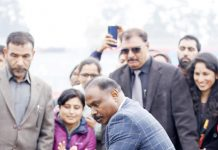LG J&K Girish Chandra Murmu testing cricketing skills while inaugurating renovated MA Stadium in Jammu. -Excelsior/Rakesh