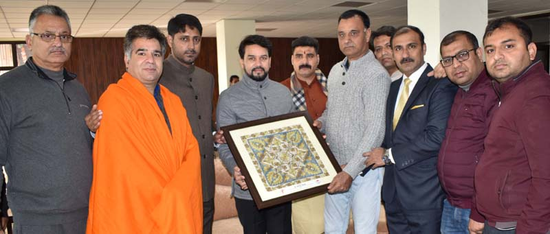 Union Minister Anurag Thakur being presented a memento during his visit to MA Stadium in Jammu.