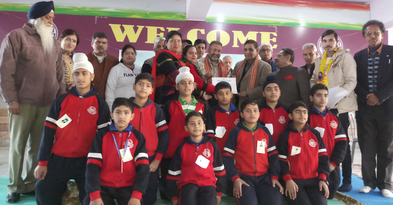 Winners of Jammu District Yoga competition posing along with chief guest and other dignitaries in Jammu.
