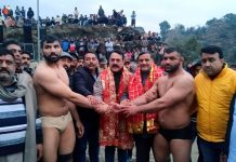 Congress leader Jugal Kishore Sharma declaring winner of Dangal at village Pamote Nalla in Reasi.