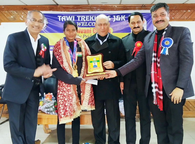 Dignitaries felicitating Shivani Charak at Saigal Hall, Abhinav Theatre in Jammu on Friday.