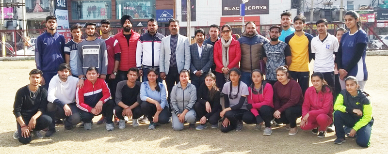 Selected Korfball team members along with dignitaries of Cluster University Jammu posing for a group photograph in Jammu.