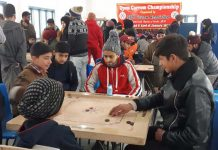 Players in action during Carrom Tournament in Srinagar.