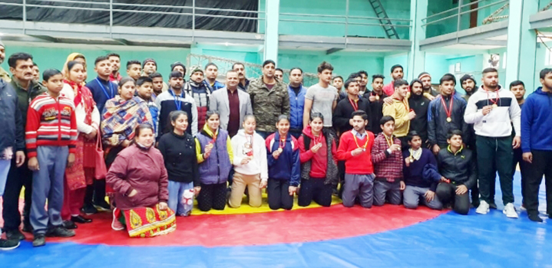 Winners of Wrestling competition posing along with officials on JU Campus in Jammu.