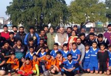 Footballers posing along with dignitaries and officials after exhibition match in Jammu.