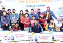 Winners of painting competition posing for a group photograph at Patnitop.