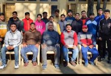Wrestling team along with coaches and office bearers of JKSC posing for a group photograph in Jammu.