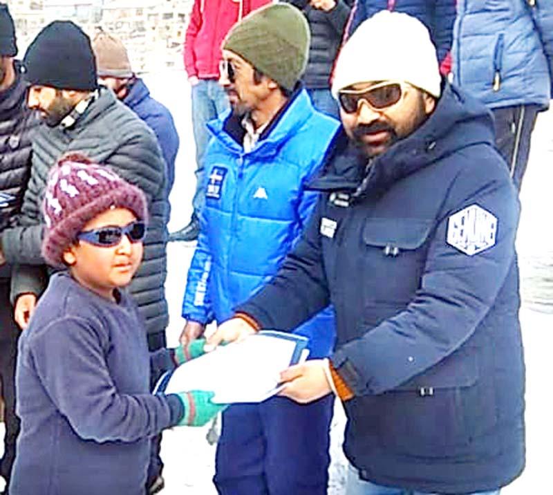 Certificate distribution during the concluding ceremony of Ice Hockey Camp in Kargil.-Excelsior/Bashrat Ladakhi
