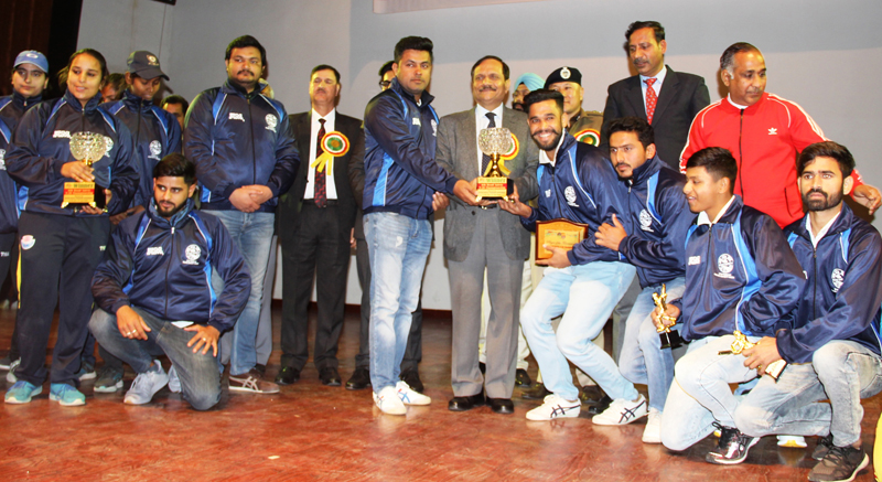 Trophy being awarded to the winners by the chief guest, RK Bhatnagar at Police Auditorium in Jammu.