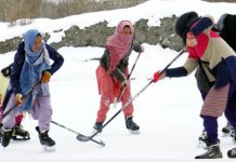 Players in action during Ice Hockey Championship in Kargil. -Excelsior/Basharat Ladakhi