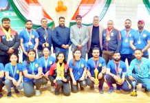 J&K Power Lifting team posing along with Secretary Sports Council in Jammu on Thursday.
