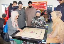 Players in action during Carrom Championship in Srinagar.