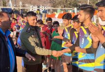 DySP Operations, Munish Sharma interacting with the players at Poonch on Friday.