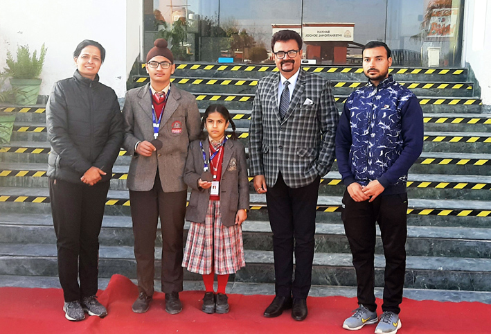 Meritorious skaters of Banyan International School posing along with Principal and coaches.