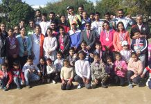Winners of various athletics events posing with Regional Director, RBI Jammu, Thomas Mathew at RBI Colony grounds in Jammu.