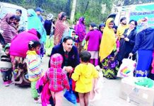 DLSA distributing clothes amongst needy.