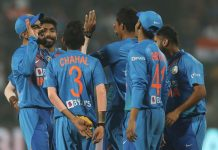 Indian players celebrating dismissal of Sri Lankan batsman during 3rd T20 at Pune.