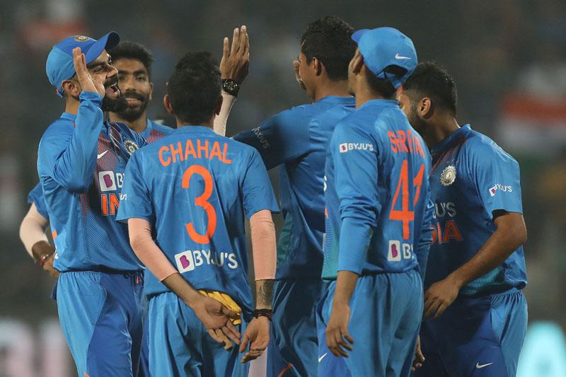 Indian players celebrating dismissal of Sri Lankan batsman during 3rd T20 at Pune.