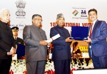Khalid Jahangir, District Electoral Officer Anantnag receiving Best Electoral Practices Award from President of India at the function of the National Voters Day at Union Capital on Saturday.