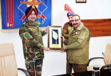 DGP Dilbag Singh presenting memento to Northern Army Commander Lt Gen Ranbir Singh at PHQ Jammu on Tuesday.