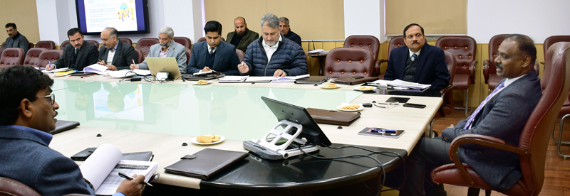 Lt Governor G C Murmu chairing a meeting in Jammu on Friday.