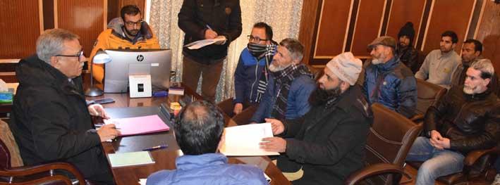 Advisor Farooq Khan interacting with a delegation in Srinagar on Friday.