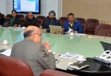 Lt Governor G C Murmu chairing a meeting on Wednesday.