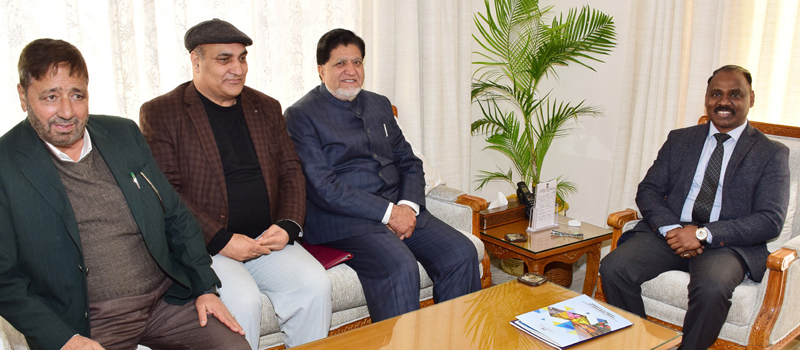 Lt Governor G C Murmu meeting former Minister Abdul Gani Kohli in Jammu on Thursday.