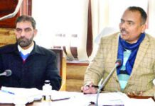 Secretary FCS&CA, Pandurang Kondbarao Pole chairing a meeting at Srinagar on Monday.