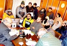 Advisor K K Sharma interacting with a delegation in Srinagar on Monday.