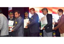 Lieutenant Governor GC Murmu presenting awards to officers in Jammu on Saturday.