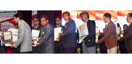 Lieutenant Governor GC Murmu presenting awards to officers in Jammu on Saturday.