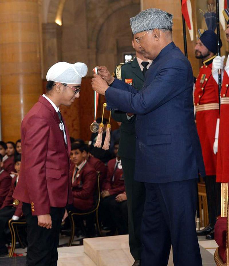 Jammu lad Onkar Singh receiving 'Bal Shakti Puraskar' from President of India Ram Nath Kovind.