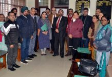 Controller of Examination with Principals of GMCs and others after a meeting on Wednesday.