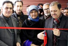 J&K Bank's Zonal Head Kashmir (Central II) Syed Shujaat Hussain Andrabi inaugurating ATM at Mirgund.