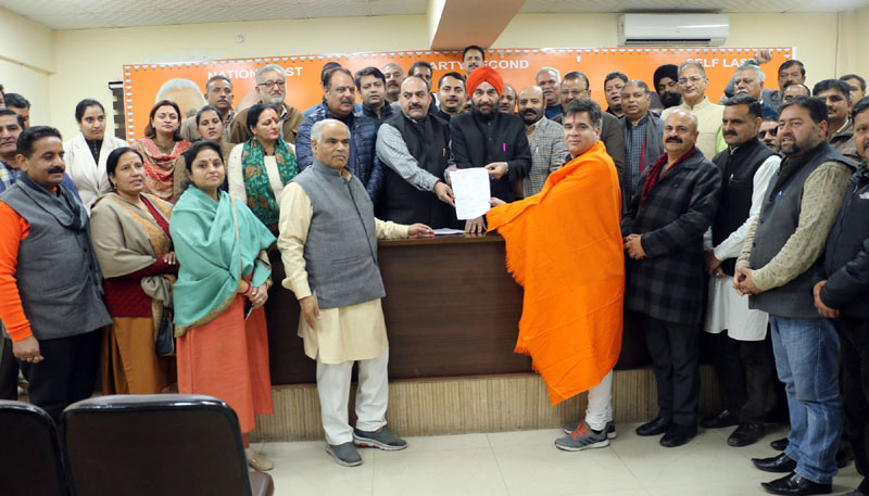 BJP State president, Ravinder Raina filing his nomination papers for his re-election as party chief at party headquarters Trikuta Nagar on Tuesday.
