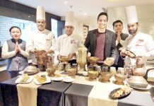 Chefs posing with Kashmiri cuisines at Chinar Restaurant in Ramada Jammu City Centre.