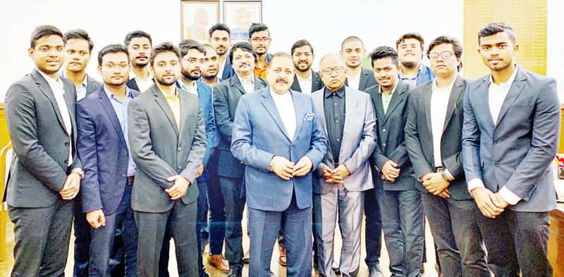 Union Minister, Dr Jitendra Singh with a group of engineering trainees from Odisha who have developed India's first-ever Satellite Launch Vehicle, at New Delhi on Friday.