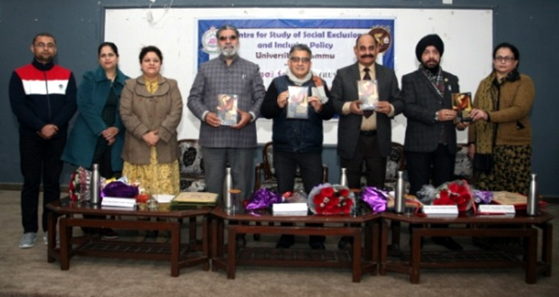 Guests releasing a book during inaugural session of a seminar by CSSEIP at JU.