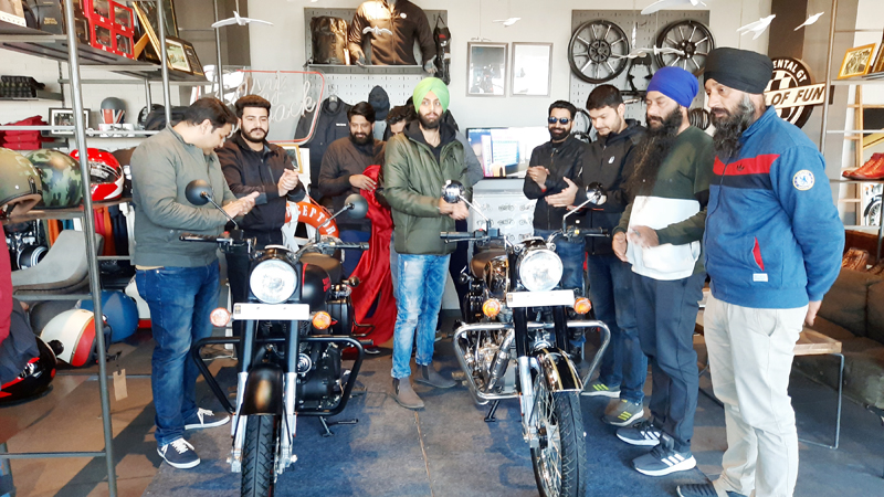 Dignitaries unveiling the Royal Enfield BS-6 Classic bike at Xtream Motors, Sainik Colony, Jammu on Sunday.