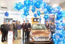 DGM SBI Jammu Ajit Parashar in presence of management of AM Hyundai unveiling The All New Aura at Jammu on Wednesday.