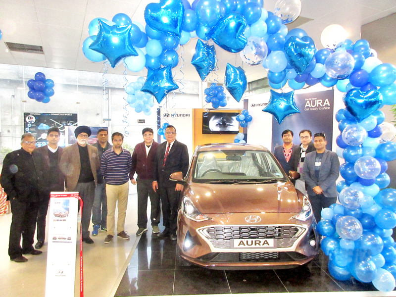DGM SBI Jammu Ajit Parashar in presence of management of AM Hyundai unveiling The All New Aura at Jammu on Wednesday.