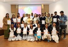 Students posing for group photograph after receiving certificates of participation with Anuradha Gupta, Director School Education and members of VKWS at Jammu.