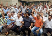 PEECC members raising slogans in support of their demands during a meeting.