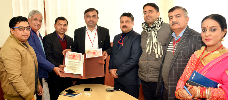 Chief Executive Officer, SMVD Shrine Board singing MoU with authorities of CSIR-CIMAP at Katra on Friday.