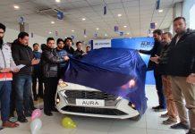 Officials unveiling all new Hyundai AURA at KC Hyundai, Srinagar.
