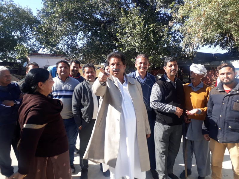PCC leader, Raman Bhalla interacting with people in Gandhi Nagar on Wednesday.