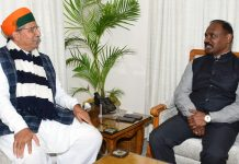 Lt Governor and Union Minister during a meeting.